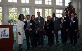 Craig Bacon of Bacon Graham Inc. accepts award (NJSBDC at William Paterson University